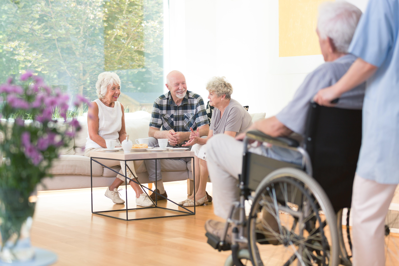 a group of elderlies having a conversation