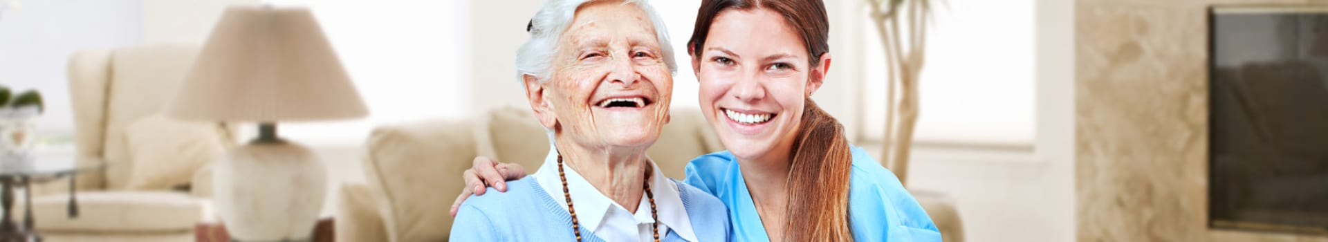 Nursing assistance and laughing happy senior citizen